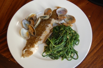 Agretti dressed with bottarga sauce, sole and clams